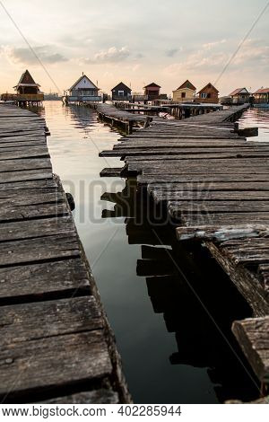 A Picture From Hungary, From A Place Called Bokod. The Local People Have The Wooden Cottages On Pylo