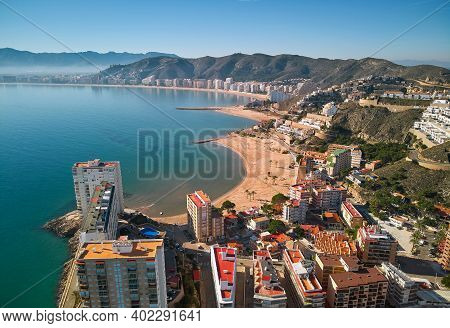 Aerial Drone Point Of View Cullera Townscape And Beach Background During Sunny Winter Day. Famous Pl