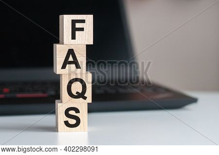 Faqs Frequently Asked Questions Text Written On Wooden Block On Computer Keyboard Against Black Back
