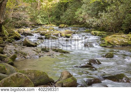 A Landscape View Of A Beautiful And Calm Flowing River Through The Great Smoky Mountains. The River