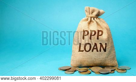 Money Bag With The Word Ppp Loan - Paycheck Protection Program. Loan Designed To Provide A Direct In