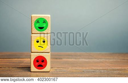 One Block With A Positive Face Stands Out From The Rest Of The Negative Emotions. Concept Of Good Ra