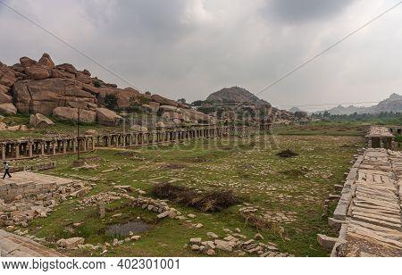 Hampi, Karnataka, India - November 5, 2013: Sri Krishna Tank In Ruins. A Green Plane With Many Gray