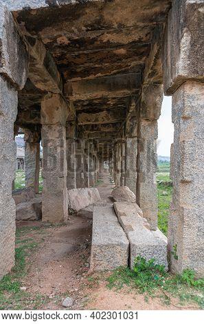Hampi, Karnataka, India - November 5, 2013: Sri Krishna Tank In Ruins. Looking Through A Gray Stone
