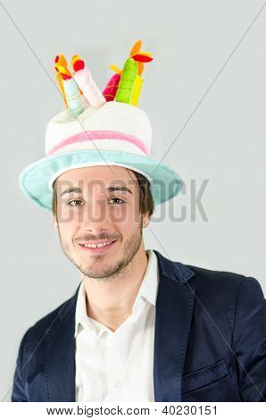 Smiling, Cute Guy With Funny Birthday Cake Hat