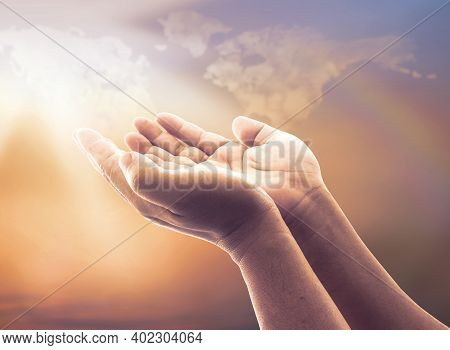Faith God Concept: Human Open Two Empty Hands With Palms Up Over Blurred World Map Of Clouds With Ra