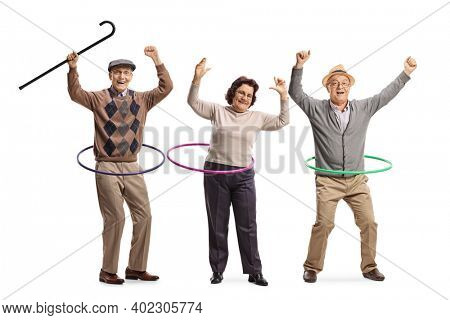 Happy elderly people spinning hula hoops isolated on white background
