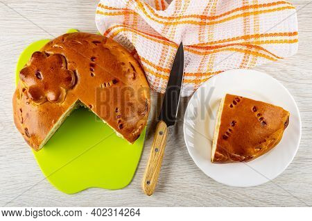 Section Of Savory Pie With Cabbage And Egg On Green Cutting Board, Kitchen Knife, Checkered Napkin,