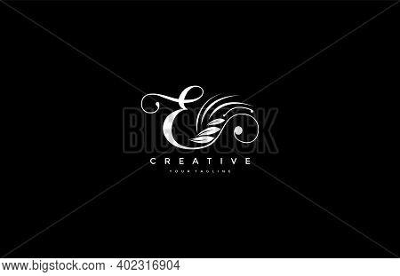 E Letter Luxury Flourishes Ornament Logogram Vector