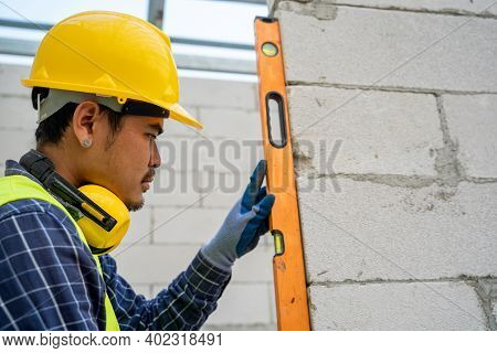 Masonry Worker Make Concrete,level Is Used When Laying Bricks In Order To Check Verticality,smooth B