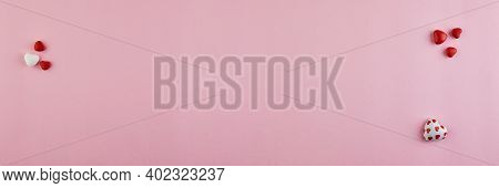 Valentines Day Banner With Candy Hearts On Pink Background. Top View With A Place For Your Greetings
