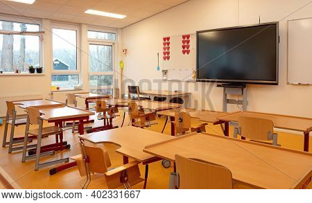 Class Of Primary School With Modern Screen, Wooden Furniture