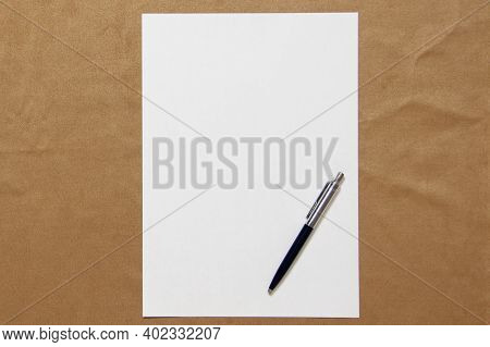 Template Of White Paper With Pen Lies On Light Brown Cloth Background. Concept Of Business Plan And
