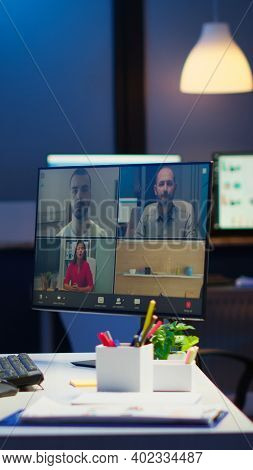 Businesswoman Talking During Video Conference With Team In Midnight Using Pc In Start Up Business Of