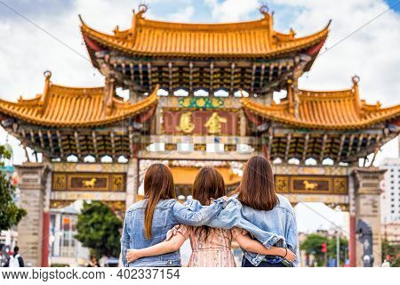 Back Side Of Three Asian Happiness Women Walking And Sightseeing Together When Travelling Over The J
