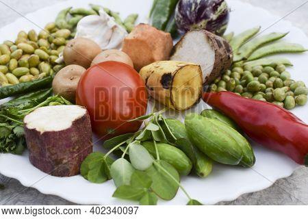 Top Vide Of All Fresh Vegetables Used In Preparation Of Making Undhiyu Or Oondhiyu A Gujarat Traditi