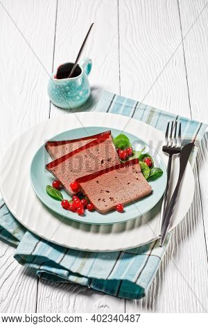 Duck Liver Pate With Cranberry Jelly On Top: French Gourmet Food On A White Plate Served With Fresh