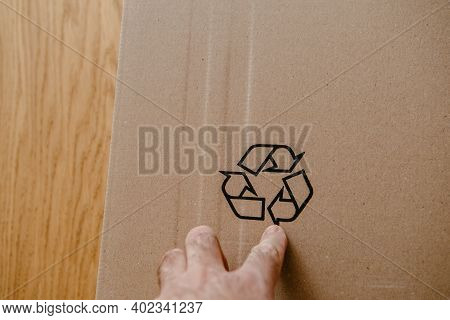 Pov Male Hand Holding Pointing At The Recycling Sign On The Cardboard Package Of A New Device