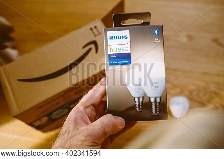 Paris, France - Dec 13, 2020: Pov Male Hand Holding After Unboxing Latest Philips Hue Signify E14 Wh
