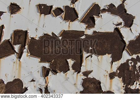 Abstract Background, Rusty Metal Plate With Traces Of White Paint, White Paint Peeling On Old Rusty