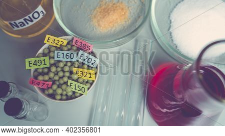 Food Additives: Chemical Additives In The Form Of Granules With Colored Labels, Sodium Nitrate In A