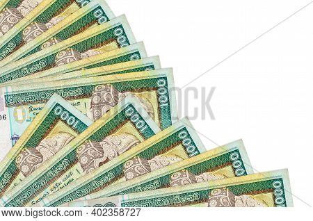 1000 Sri Lankan Rupees Bills Lies Isolated On White Background With Copy Space Stacked In Fan Close