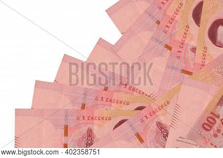 100 Thai Baht Bills Lies In Different Order Isolated On White. Local Banking Or Money Making Concept
