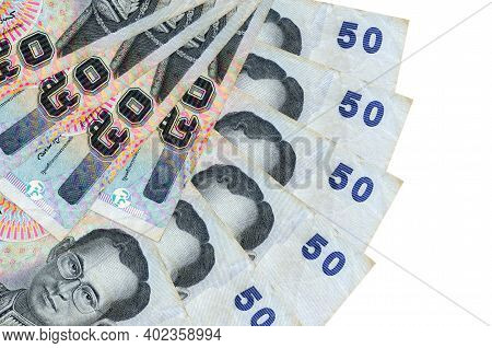 50 Thai Baht Bills Lies Isolated On White Background With Copy Space Stacked In Fan Shape Close Up.