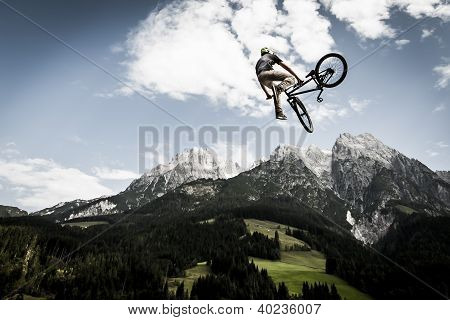 freestyler jumps with his bmx