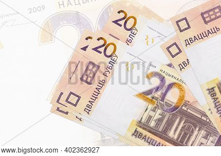 20 Belorussian Rubles Bills Lies In Stack On Background Of Big Semi-transparent Banknote. Abstract P