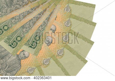 20 Thai Baht Bills Lies Isolated On White Background With Copy Space Stacked In Fan Shape Close Up.