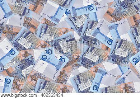 10 Belorussian Rubles Bills Lies In Big Pile. Rich Life Conceptual Background. Big Amount Of Money