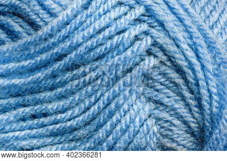 Cropped Skein Of Pale Blue Woolen Knitting Thread Texture. Ball Of Soft Woolen Yarn Full Frame Macro