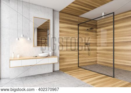 Wooden And White Bathroom With Sink, Mirror And Drawers, Shower With Glass Doors, Side View. Minimal