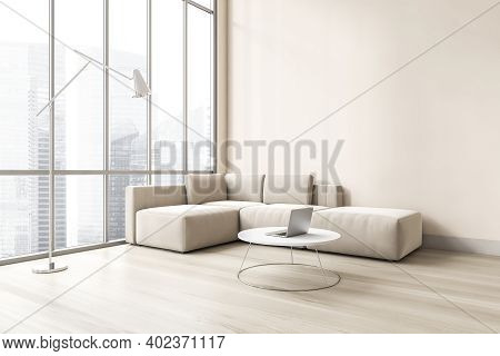 Light Living Room With Large Window, White Corner Sofa And Coffee Table With Laptop, Side View. Sofa