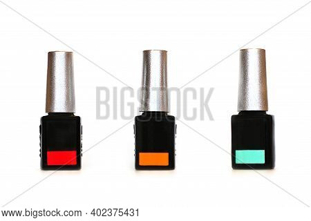 Nail Polish On A White Background. Large Selection Of Nail Polishes. Manicure
