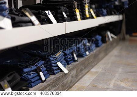 Stack Of Blue And Black Jeans In A Shop.
