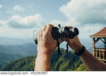Hands Holding Binoculars On Mountains Forest Nature Background, Looking Through Binoculars, Travel,