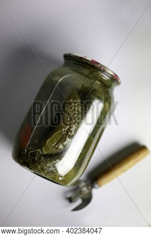 Jar Of Homemade Marinated Pickles With A Bottle Opener