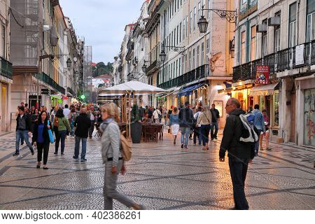 Lisbon, Portugal - June 5, 2018: Shoppers Visit Rua Augusta Shopping Street In The Evening In Lisbon