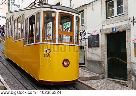 Lisbon, Portugal - June 6, 2018: People Ride The Bica Funicular (ascensor De Bica) Railway Line In L