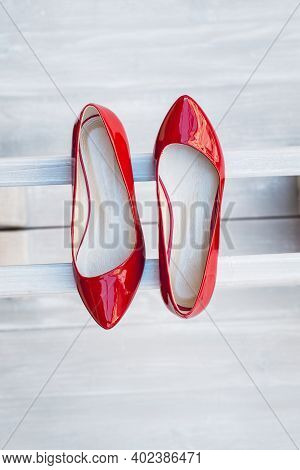 Leather Red Womens Shoes On A White Wooden Shelf. Fashion, Minimal Fashion Concept, Womens Shoes, Ac