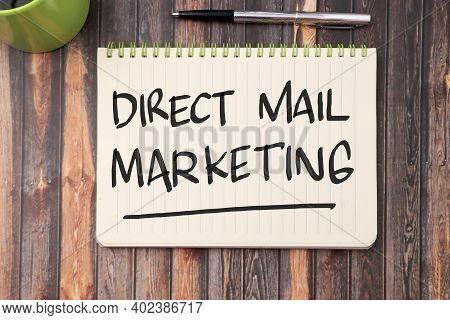Direct Mail Marketing, Text Words Typography Written On Book Against Wooden Background, Business Mar