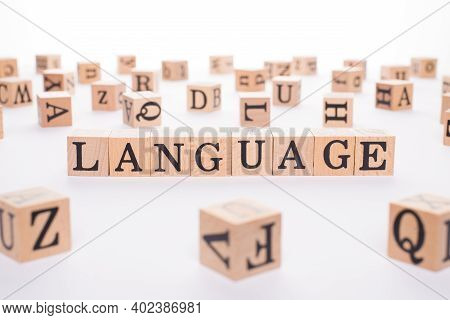 Language Studying Concept. Close Up View Photo Of Wooden Cubes Making Word Language Isolated White B
