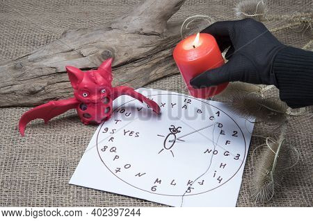 Fortuneteller's Black Gloved Hand Burning Candles. Preparing For Spiritualism Ritual. Candle, Bat An