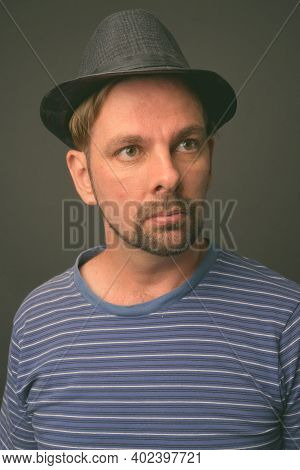 Blond Bearded Tourist Man With Goatee Against Gray Background