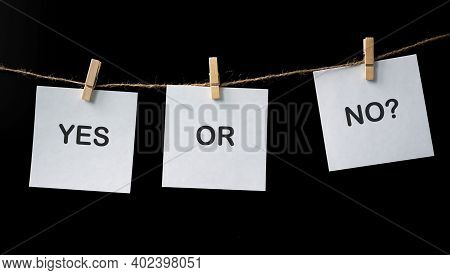 Handwriting Of Message Yes Or No On Sticky Note Paper On Balck Wall Texture Background, Loft Style