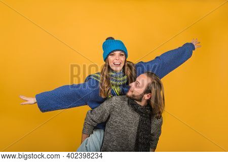 Happy Couple In Warm Clothes. Couple In Love. Fashionable Man With Scarf And Hat In Autumn Winter Ti