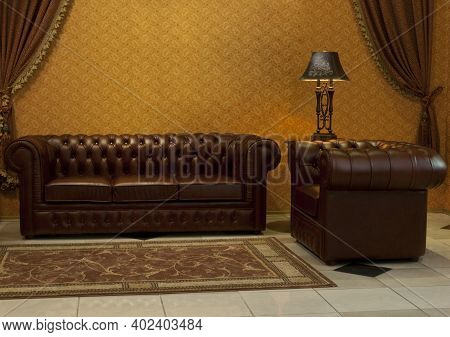 Empty Interior Living Room Background In Warm Colors Decorated With Classic Luxury Leather Furniture
