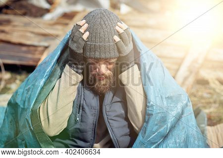 Sad And Upset Homeless And Unemployed Person In Ruins, Economic Collapse And Poverty, Job Loss, Unem